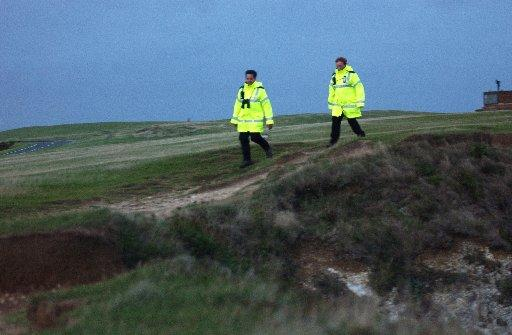 Volunteers patroling the cliffs at Beachy Head
