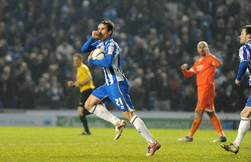 David Lopez celebrates after converting an 88th-minute penalty against Millwall