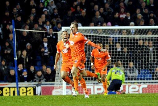 Chris Wood celebrates after scoring Millwall's second goal at The Amex on Tuesday night