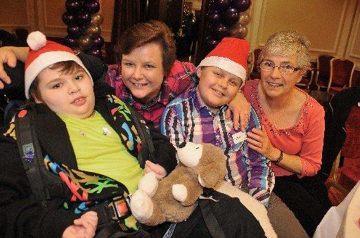 Craig, Trina and Adam Beckett with Janet Milligan at the Royal Alexandra Children's Hospital Christmas Party