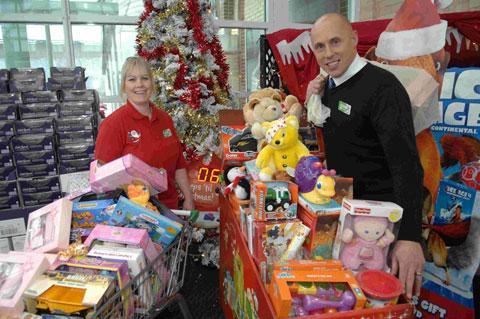 Kerry Ancell and Darren Evans with toys donated by Asda shoppers in Brighton
