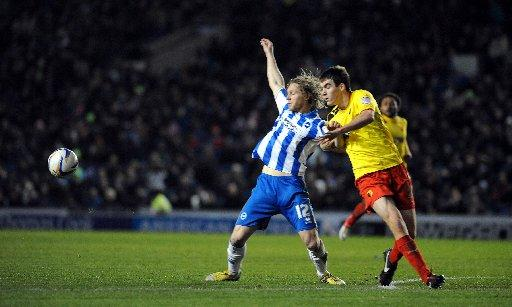 Craig Mackail-Smith is hauled back against Watford