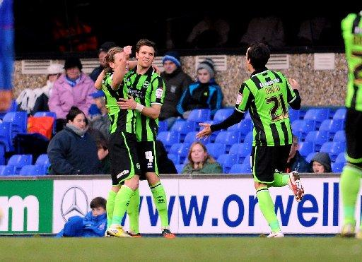Craig Mackail-Smith celebrates his goal with Dean Hammond and David Lopez