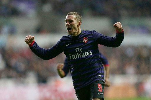 Lukas Podolski celebrates scoring for Arsenal against Swansea today