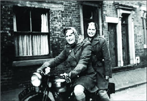 The hut was home to Vera Barlow (driving) and Edith Hooper (pillion) for 56 years