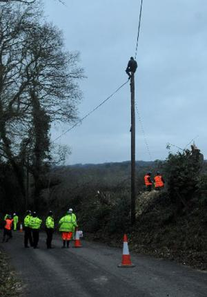 Protesters up a telegraph pole