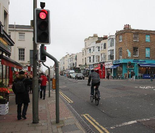 A cyclist going through a red light along Western Road