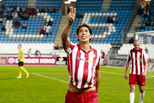 Leonardo Ulloa celebrates a goal for Almeria