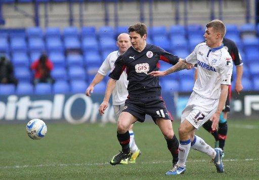 Josh Simpson on the ball for Reds at Tranmere