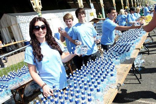 Volunteers working at a water stand at the Brighton Marathon