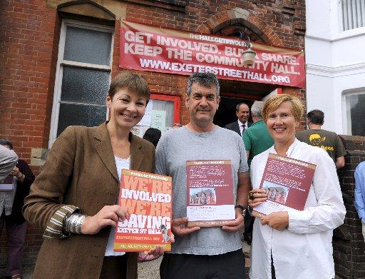 CAMPAIGN: Caroline Lucas MP joins local residents to buy the first share in THEHALLGETINVOLVED Campaign to save the Exeter Street Hall in Brighton