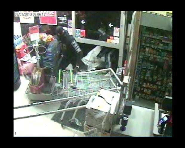 CCTV image of two men wanted after Hove shop break-in