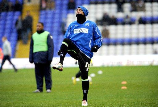 Leonardo Ulloa warms up at Birmingham