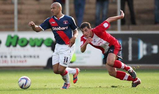 Joe Walsh in action for Crawley