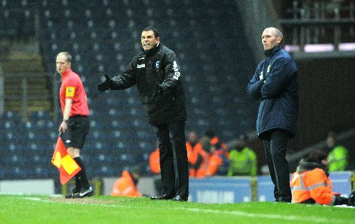 Gus Poyet looks concerned on the sidelines at Ewood Park