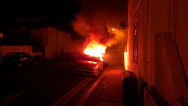 A car on fire in St Patrick's Road (Dave Simpson)