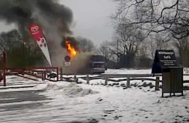 The school coach on fire on the A29 near the White Ways Café