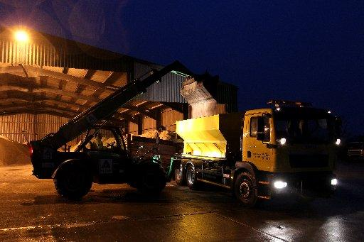 Gritters loaded up with salt at Pookbourne Lane depot off the A2300