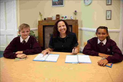 Head teacher Janet Felkin and two Year 7 students