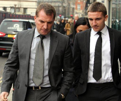 Anton Rodgers (right) walking into court with Liverpool manager dad Brendan Rodgers
