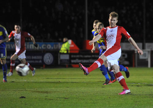 Clarke on the spot to earn Crawley a point