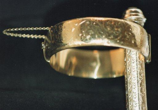 A wide banded ring stolen from a bungalow in Old Fort Road, Shoreham