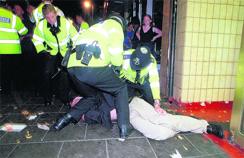 Police tackling drunk and disorderly people in Brighton