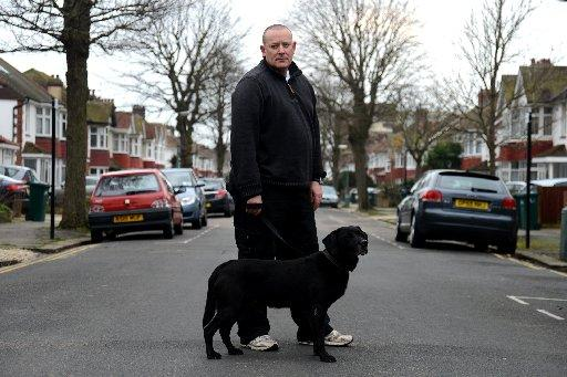Neil Macadam with his dog George in Berriedale Avenue, Hove