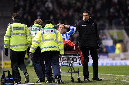 Will Hoskins gets a consoling word from manager Gus Poyet as he is stretchered off