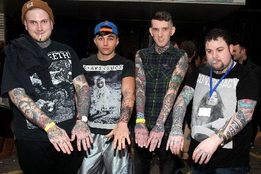 Tattoo fans show off their designs at The Tattoo Convention