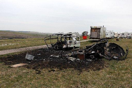 Two burnt out caravans pictured on the road up to Devils Dyke