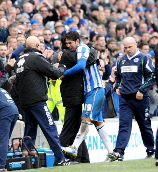 Leo Ulloa gets a hug from Gus Poyet