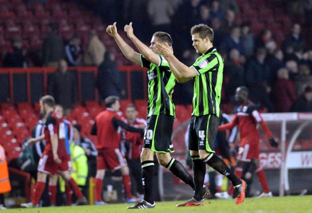 Matthew Upson and Dean Hammond salute the fans after the draw (photo Simon Dack)