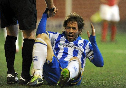 Battered and beaten Inigo Calderon after the defeat (photo Simon Dack)