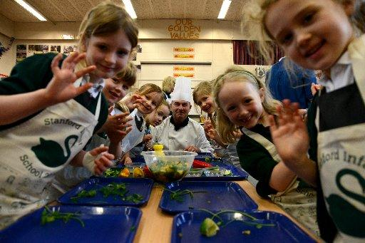 Pupils at Stanford Infant School with chef Colin Marshall