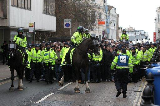 Police escort fans up Queen's Road, Brighton