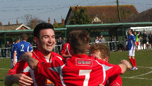 Whitehawk celebrate victory at Leiston last Sunday which all but clinched the title. Picture by Mike Lane