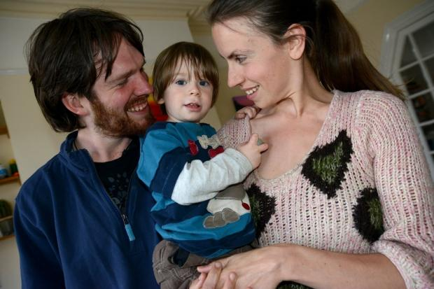 Matt and Adele Allen with their son Ulysses, who was left attached to his placenta until it fell away