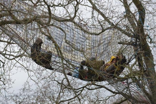 The Combe Haven Defenders, who locked themselves to trees in an attempt to prevent the building of the Bexhill to Hastings Link Road (BHLR), have told developers they will face similar action