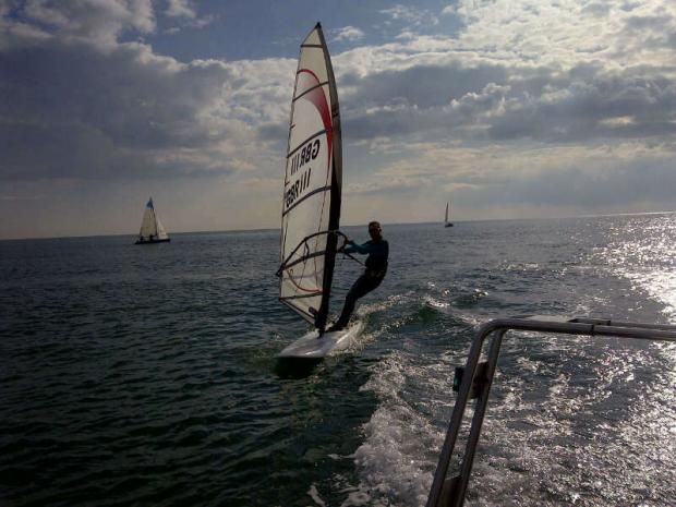 Paul Hopkins pulls on a wetsuit and windsurfs from Hove Lagoon to Brighton Marina to work.