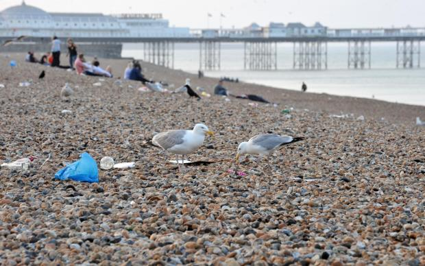 Beach fun in the sun brings litter by tonne at Brighton and Hove
