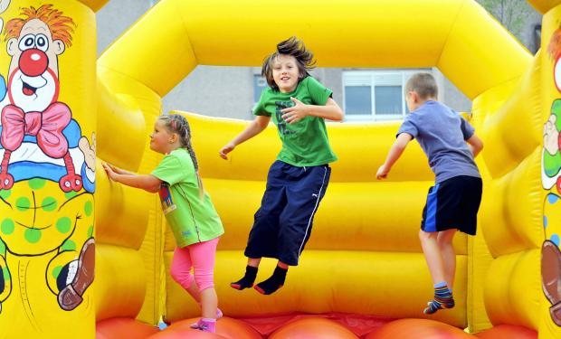 A bouncy castle will be among the entertainment at the event (stock photo)