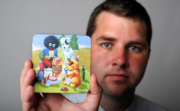 Reporter Bill Gardner with the controversial golliwog place mat