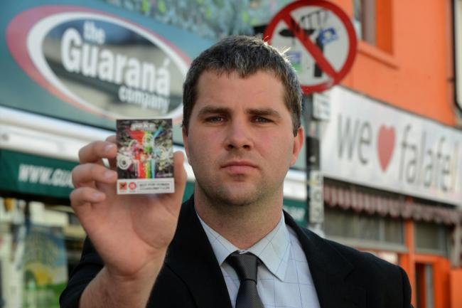 Reporter Bill Gardner with a shop-bought packet of the deadly legal high 'poke'