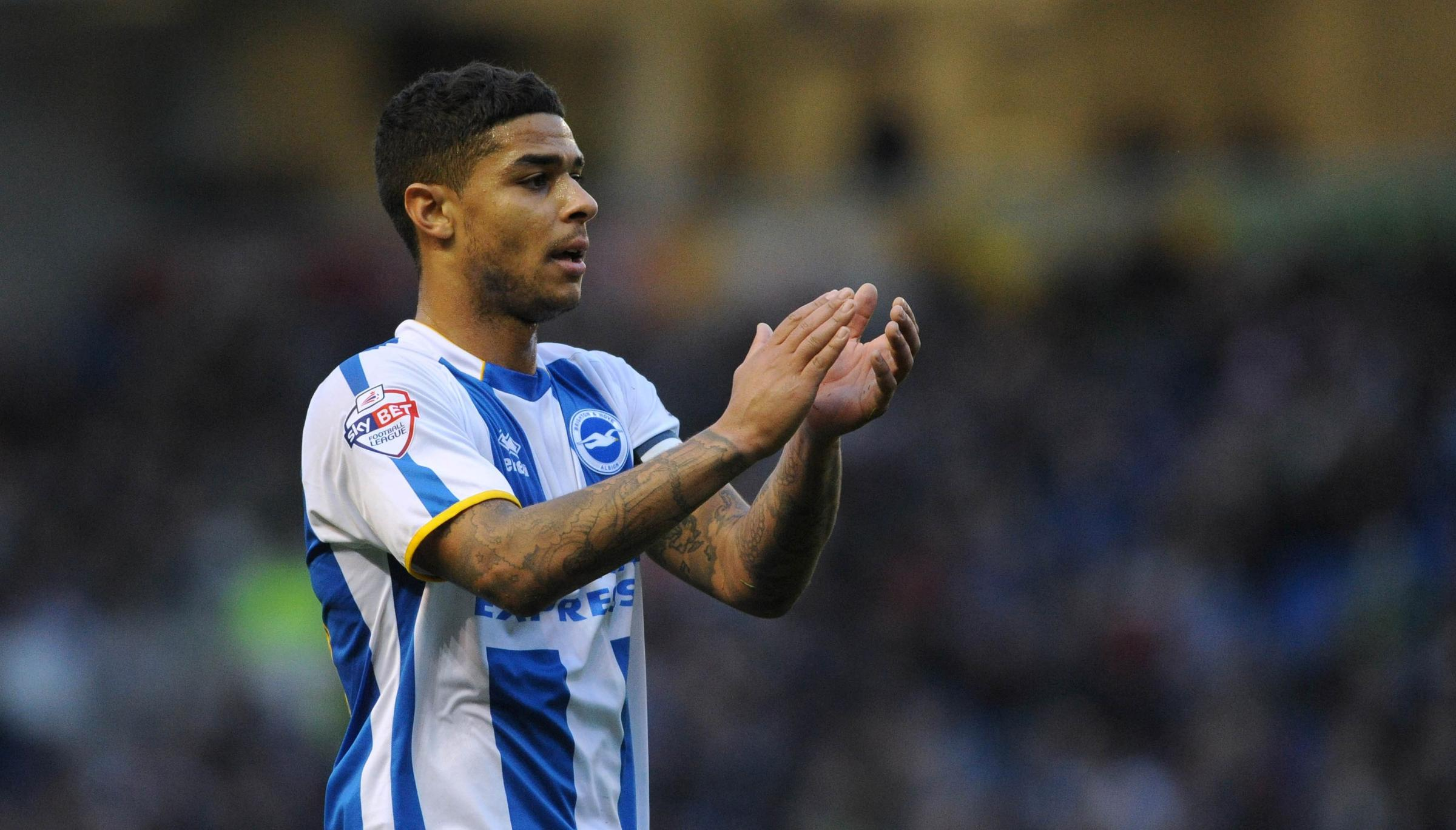 Liam Bridcutt claps the fans at The Amex in what turned out to be his last game for Albion against Bournemouth