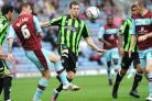 Ashley Barnes (right) in action for Albion against Burnley. Now he is looking forward to playing for them against the Seagulls.