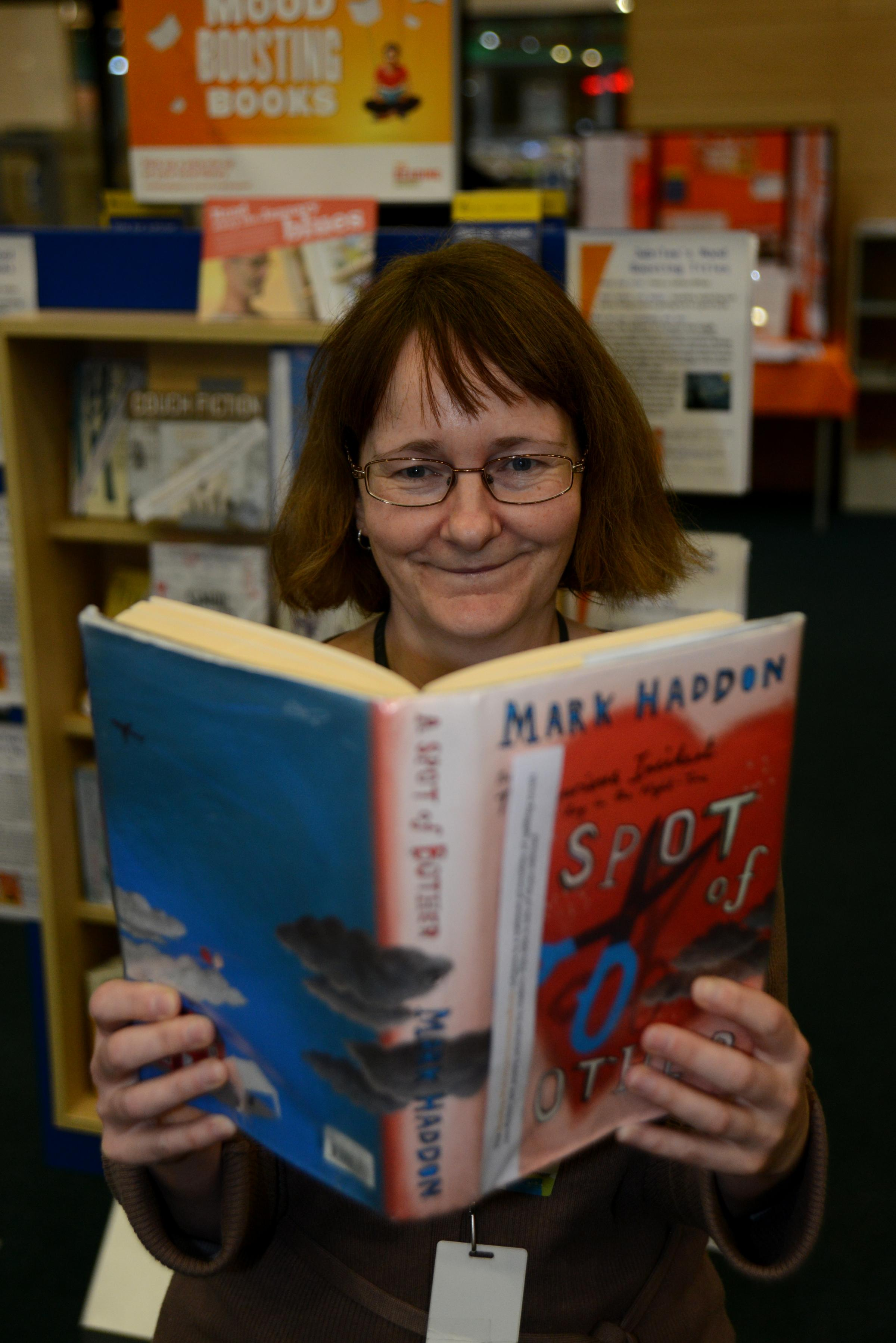 Librarian Julie O'Neil, who created Jubilee Library's display of mood-enhancing books