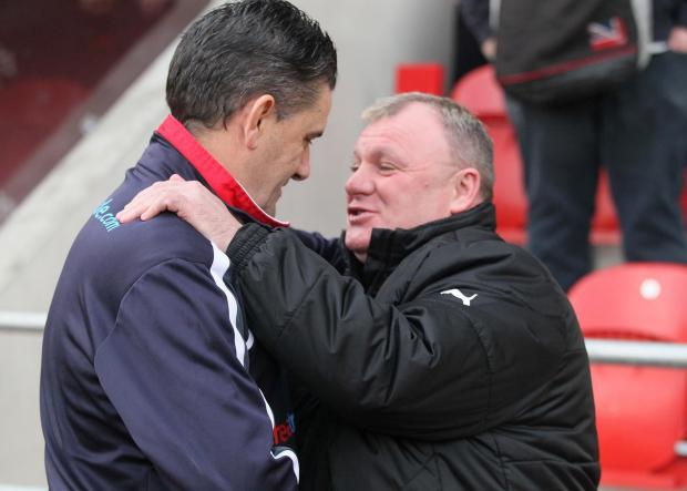 John Gregory with Rotherham boss Steve Evans on Saturday