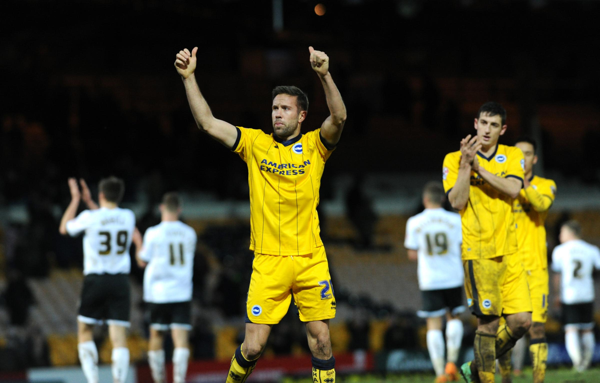 Matt Upson celebrates after Albion's win at Port Vale on Saturday