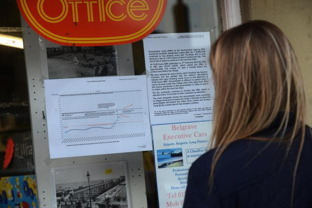 The Argus: A Patcham resident reads a flooding notice in the post office window